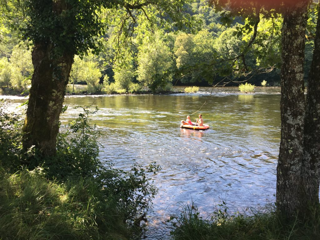 Father and daughter take their chances on the rapids Dordogne fun kids small campsite