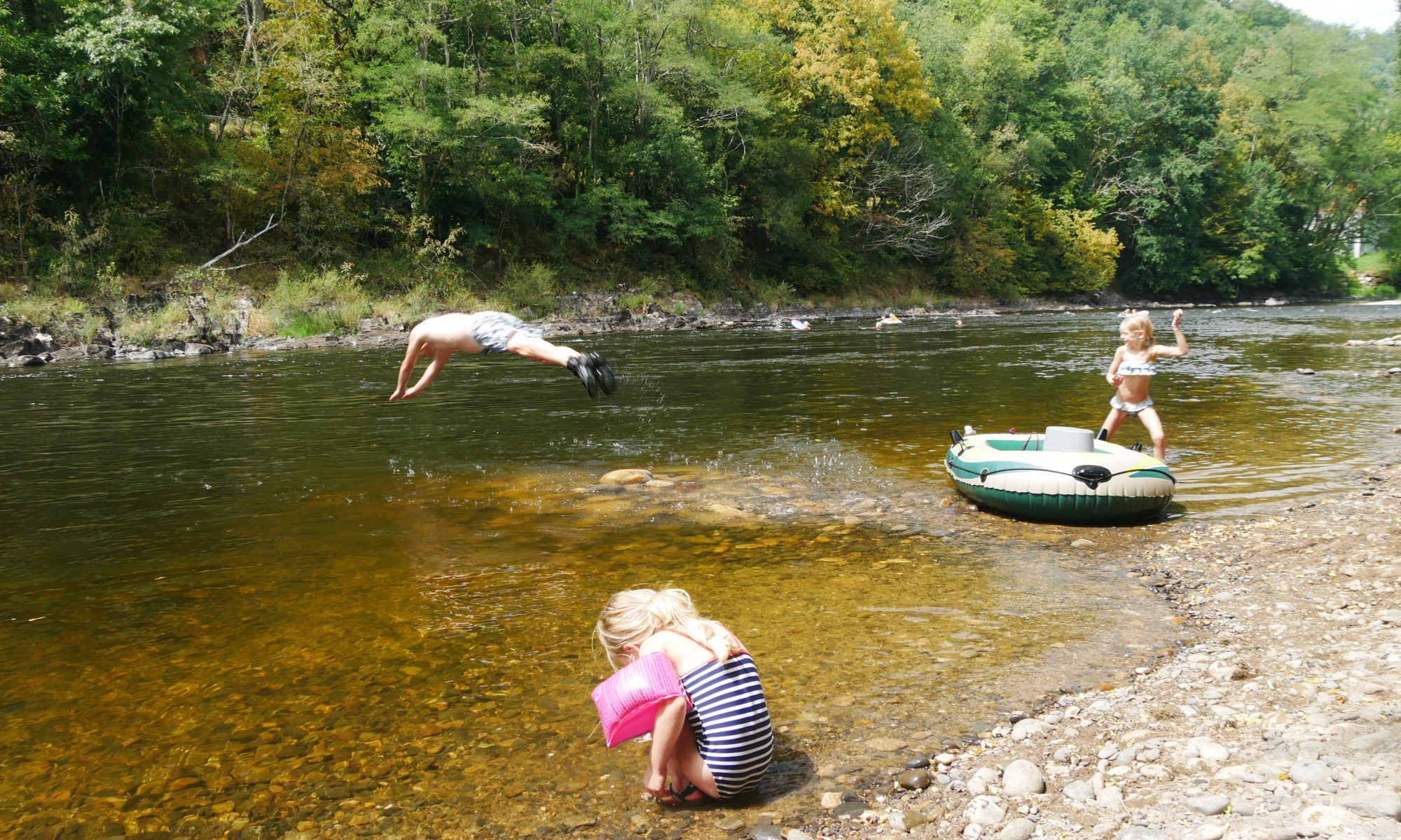 Water swimming diving into river Dordogne small campsite