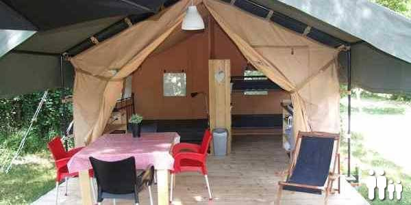 Interior safari tent at campsite La Champagne the small campsite on the Dordogne
